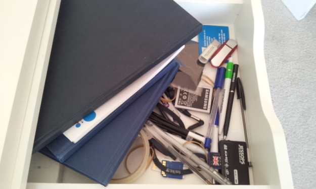 Four notepads and eight pens in my top drawer